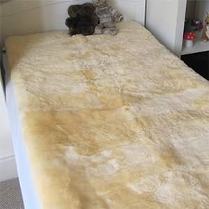 Peau d'agneau pour le lit 90X190cm Fellhof