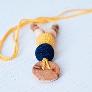Collier d'allaitement / portage KangarooCare jaune/bleu marine Genévrier